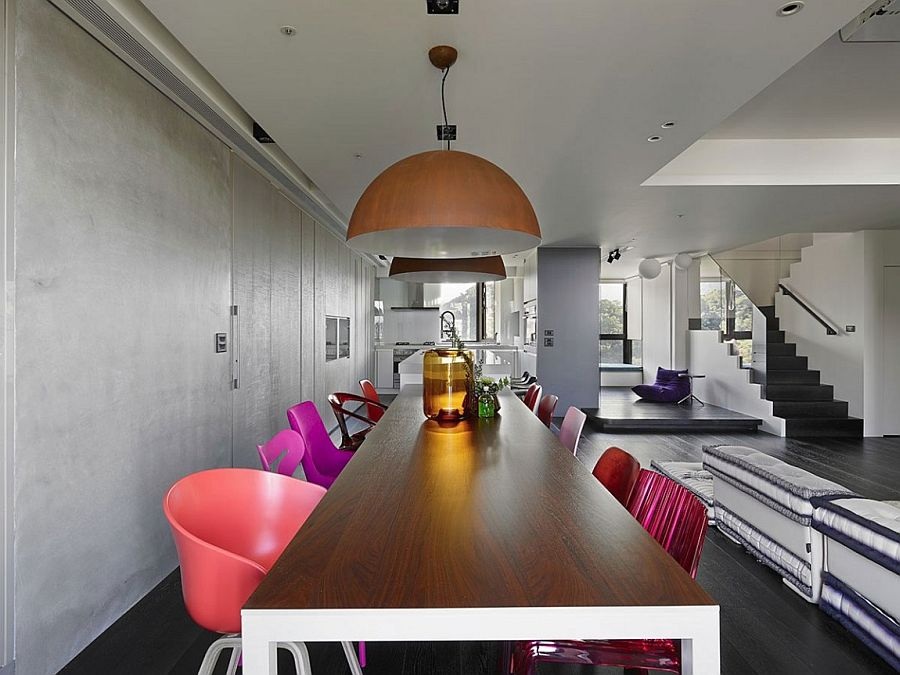 Eclectic mix of colorful chairs for the chic dining room