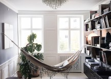 Elegant hammock over over a Moroccan Beni Quarain Rug 217x155 18 Indoor Hammocks to Take a Relaxing Snooze In Any Time