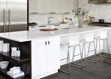 Elegant white kitchen island with dark, open shelves