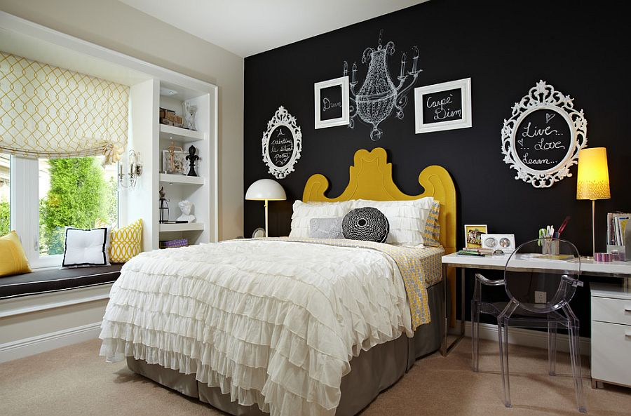 Empty picture frames and chalkboard paint create a vibrat accent wall in the bedroom