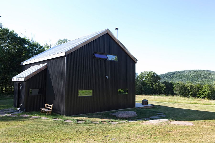 Exterior of the rustic home clad in black corrugated metal