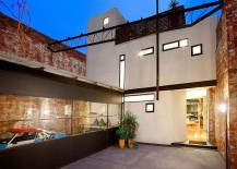 Exterior-of-the-warehouse-residence-preserves-the-original-character-of-the-brick-wall-building-217x155