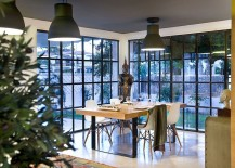 kept to a bare minimum as an open floor plan visually connects the kitchen the dining space and the family zone one can see industrial style lighting - Beach Style Apartment 2015