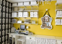 Fabulous wall shelves and yellow accent wall enliven the cool home office