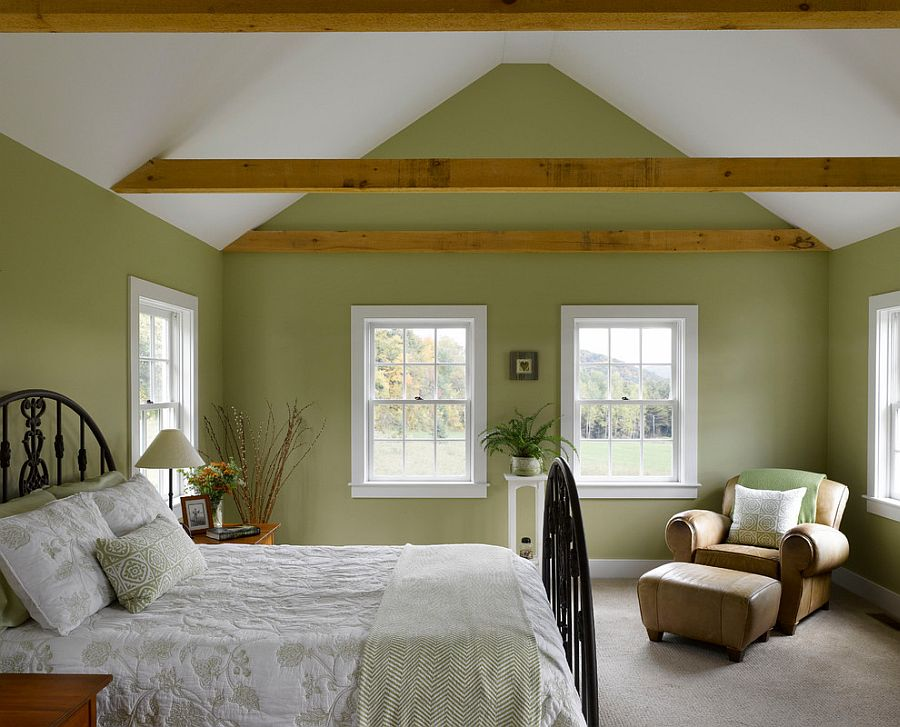 Farmhouse style bedroom in white and green with wooden beams [Design: Connor Homes]