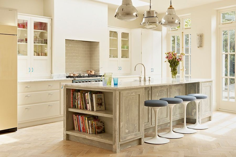 Farmhouse style kitchen with a lovely island that complements its style [Design: Godrich Interiors]