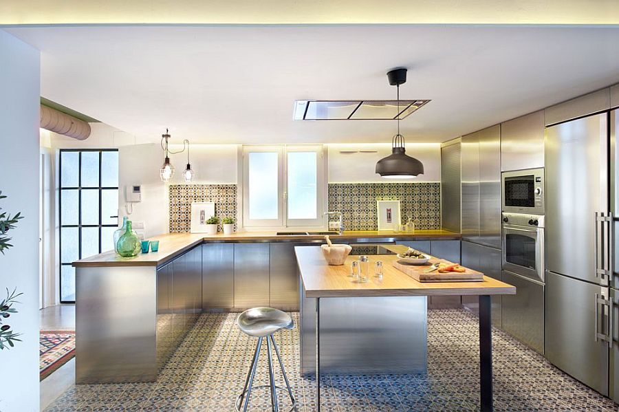 Fascinating use of geometric tiles, stainless steel surfaces and industrial lighting in the kitchen