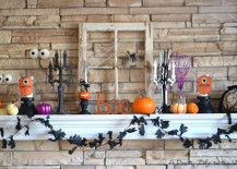 Fireplace mantel with tiny Halloween accents 217x155 18 Spooktacular Halloween Ideas for Your Fireplace Mantel