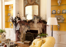 Fireplace with Halloween skulls skeletons and branches 217x155 18 Spooktacular Halloween Ideas for Your Fireplace Mantel