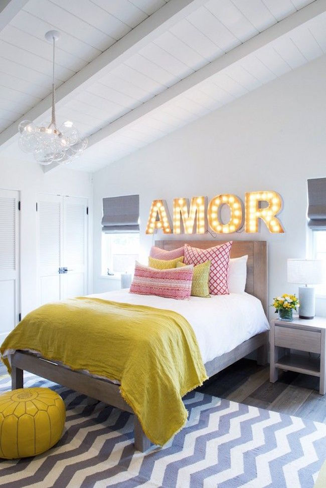 Four marquee letters to spell the word amor