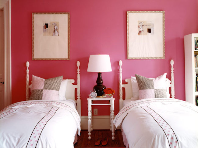 French cane beds against a boldly painted wall