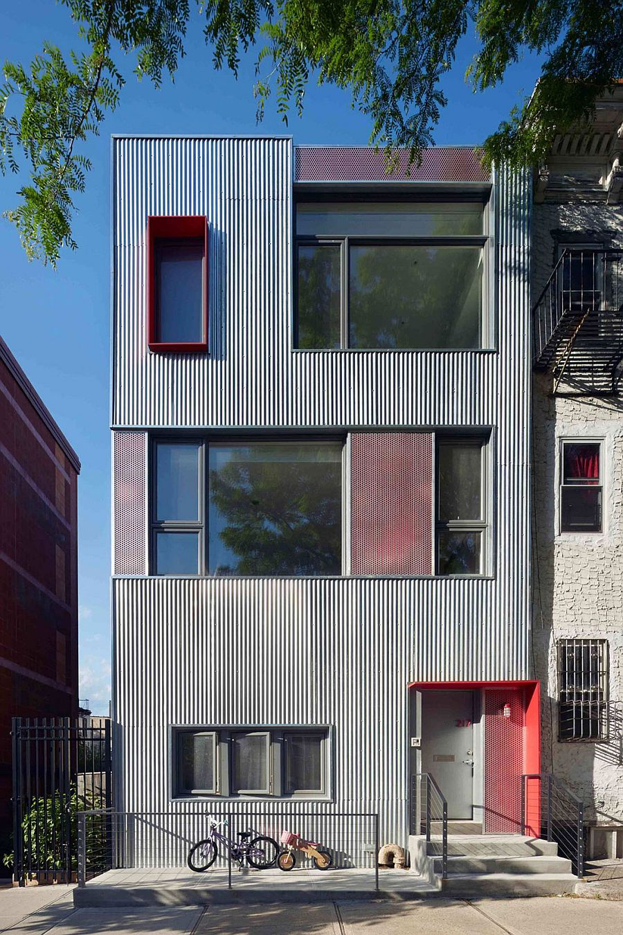 Galvanized steel shapes the distinct extreior of the renovated home Budget Brooklyn Renovation Fuses Industrial Sparkle with Modern Style