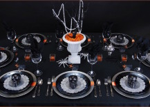 Ghoulish glam Halloween table setting with black skulls