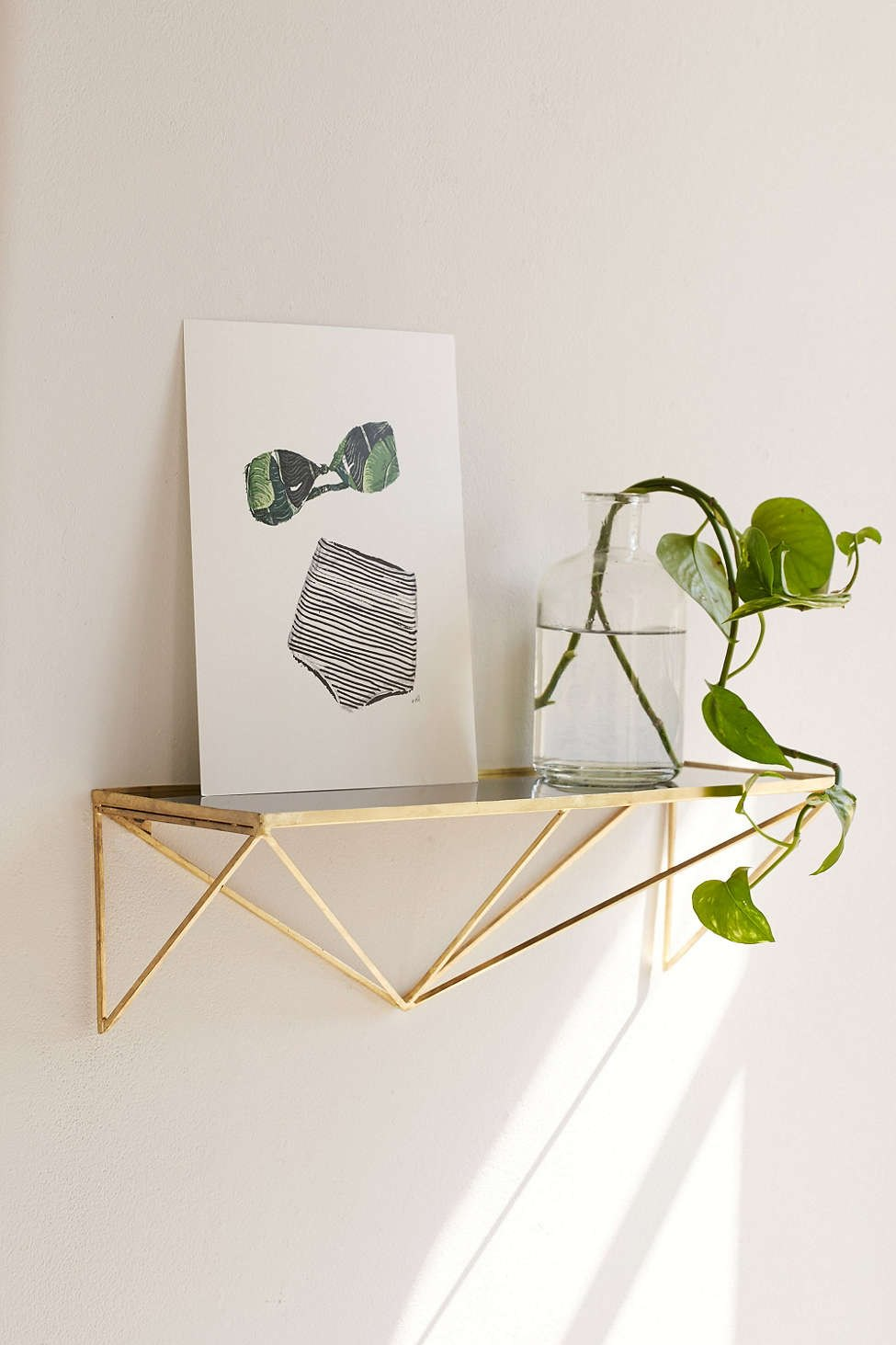 Glass and aluminum shelving from Urban Outfitters