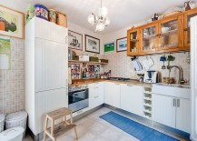 Glass front wooden cabinets and a custom refrigerator for the cool eclectic kitchen