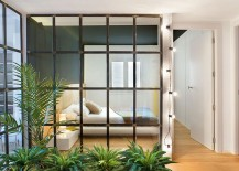 Glass partitions with steel frame give the interior an airy appearance