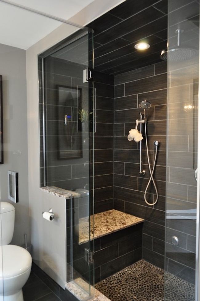 Gorgeous black tiled shower with built-in bench