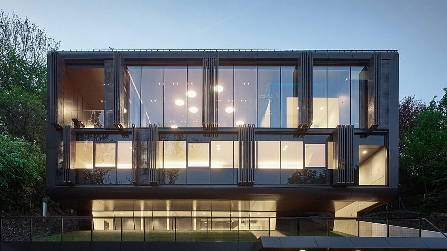 Gorgeous glass facade of the Austrian residence with electrically driven shading system