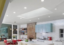 Gorgeous kitchen and dining area design with red accents