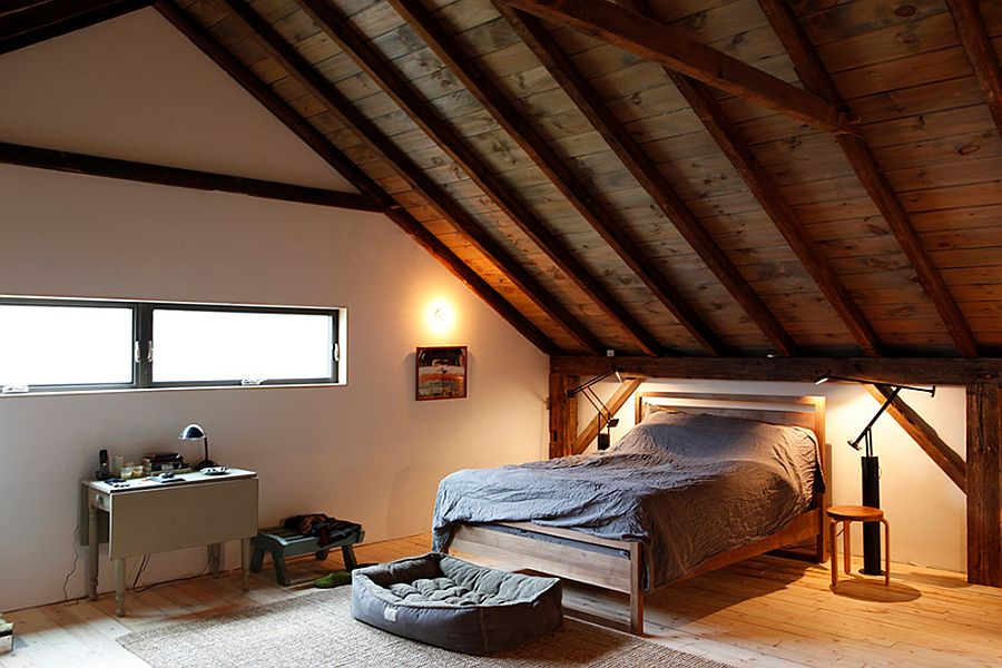 Gorgeous rustic bedroom design on the top level of the barn home