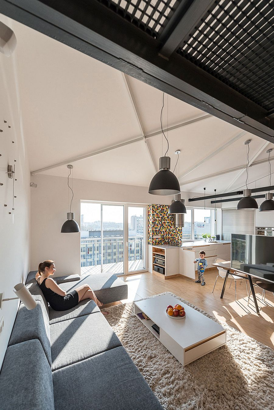 Gray industrial lighting adds to the appeal of the living zone