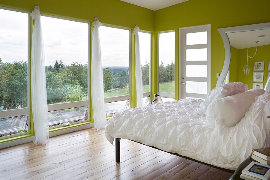 Green and white create a cozy setting in the contemporary bedroom [Design: Alan Mascord Design Associates]