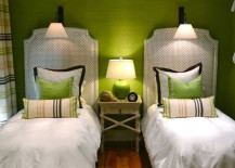 Green guest room with matching accent pillows for twin beds