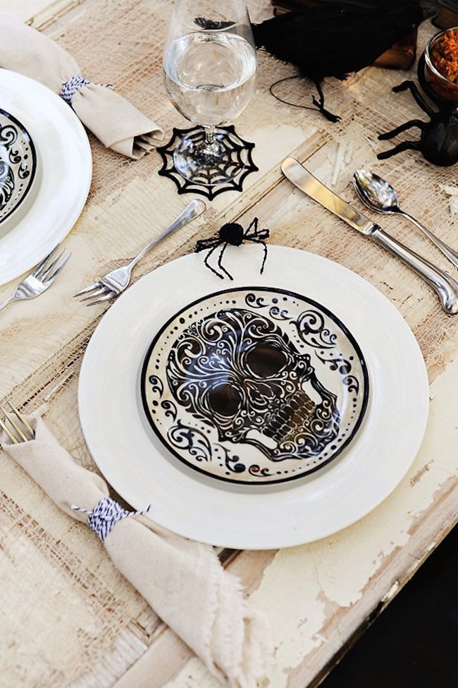 Halloween-themed skull plates and spiderweb glasses