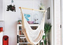 Hammock hung betwee the kitchen and a bright window 217x155 18 Indoor Hammocks to Take a Relaxing Snooze In Any Time