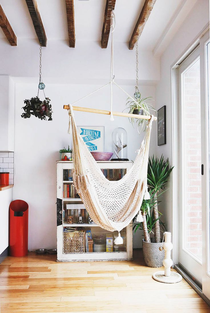 Hammock hung between the kitchen and a bright window
