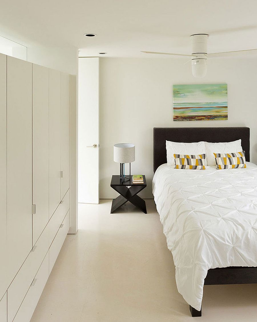 Headboard and nightstand bring black to the all-white bedroom