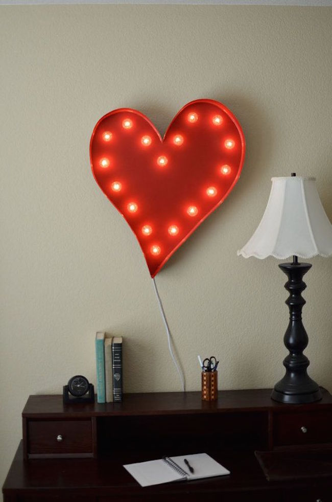 Heart marquee sign hung above desk