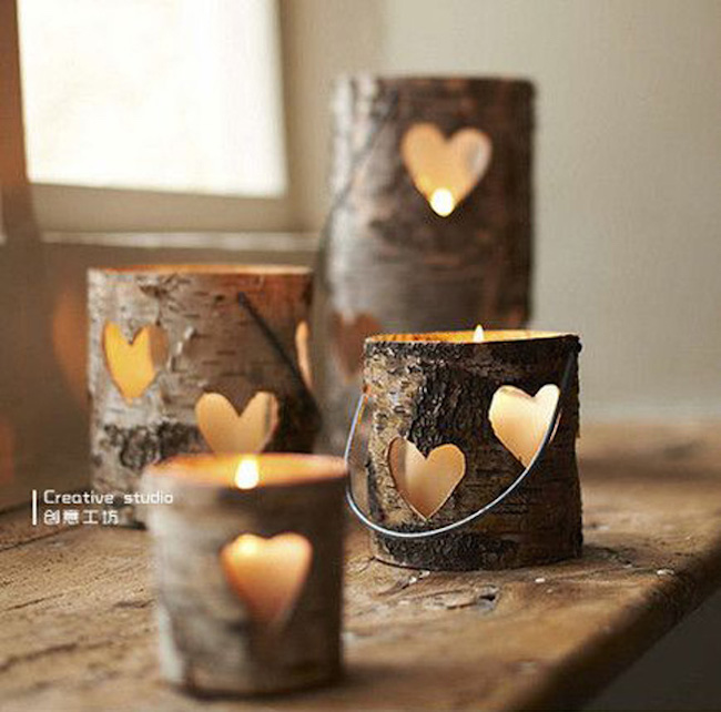 Hollowed out logs with heart shapes cut out of the sides
