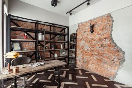 Home office with brick wall and a metal shelf