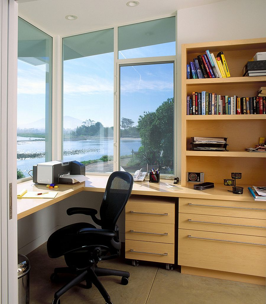 Home office with smart wooden shelves and a refreshing view