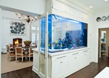 Huge fish tank separating dining room from kitchen 217x155 8 Extremely Interesting Places to Put an Aquarium in Your Home