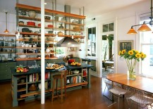 Industrial kitchen with ceiling-hung shelves and an island with open shelves as well!