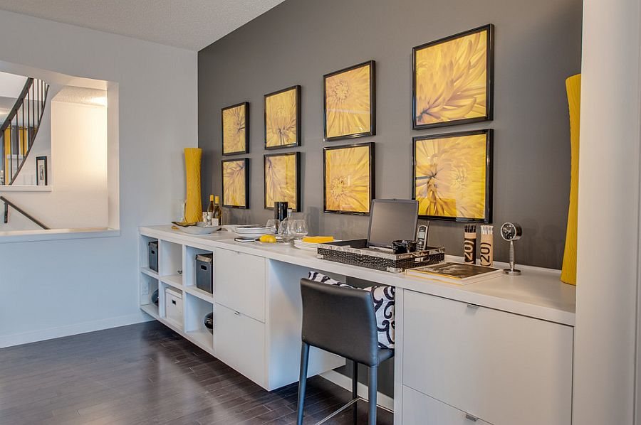 Interesting use of modern prints to add yellow to the home office [Design: Brookfield Residential]