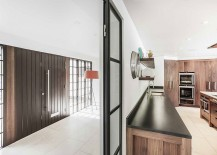 Kitchen and loggia of the revamped Surrey home with lovely wooden elements