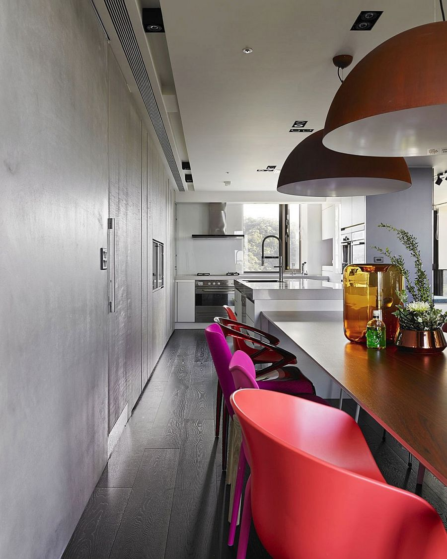 Kitchen counter seems to extend into the dining room visually