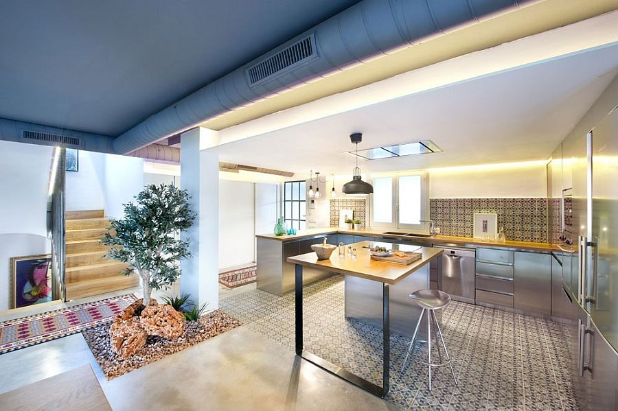 Kitchen fueses Mediterranean style with modern and industrial touches