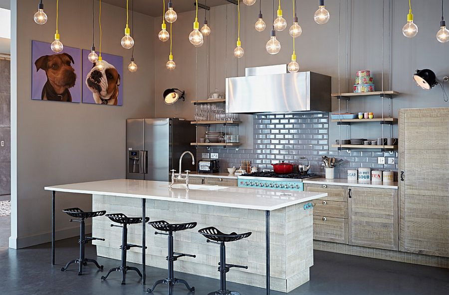 Kitchen in gray with brilliant yet simple pendant lighting [Design: Godrich Interiors]