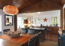 Kitchen island used as firewood stacker in this beach style home