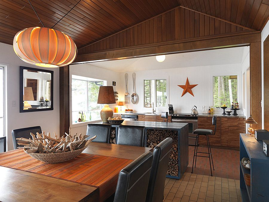 Kitchen island used as firewood stacker in this beach style home [Design: Johnson + McLeod Design Consultants]