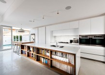 Kitchen island with bookshelves is an absoulte showstopper in contemporary Perth home