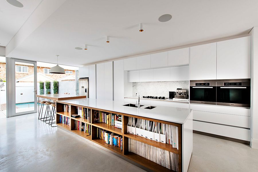 Kitchen island with bookshelves is an absolute showstopper in contemporary Perth home [Design: Mata Design Studio]