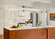 Kitchen-island-with-stone-worktop-and-wooden-cabinets-217x155