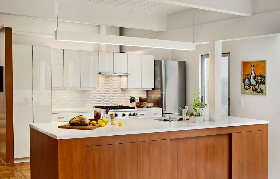Kitchen island with stone worktop and wooden cabinets