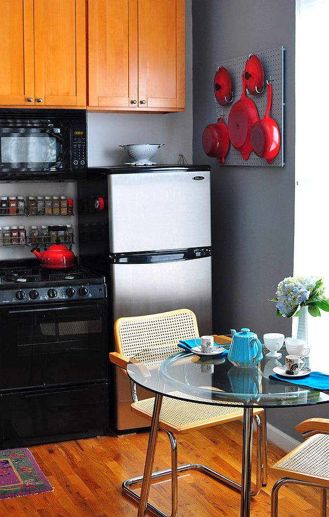 Kitchenware adds bright red to the small kitchen in black and gray [Design: Scheer & Co]