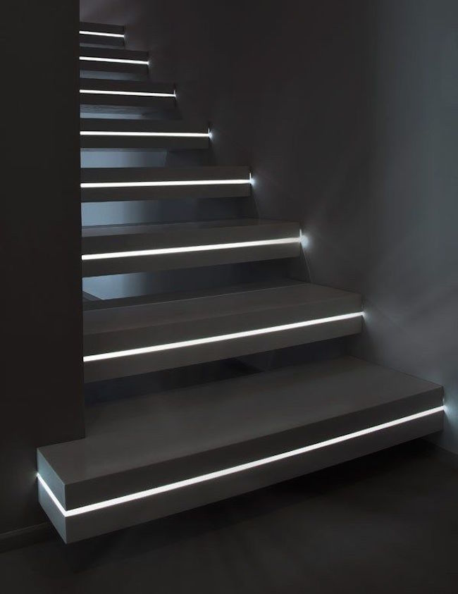 LED light strips positioned in the middle of each step